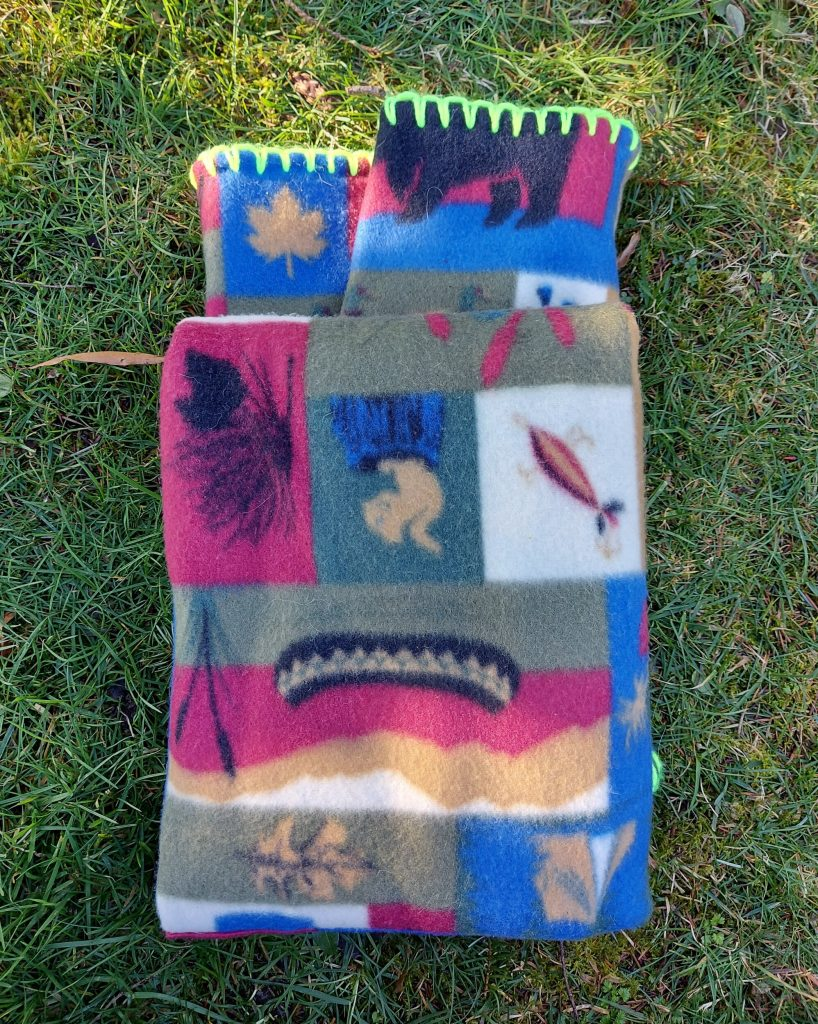 folded blanket on the grass