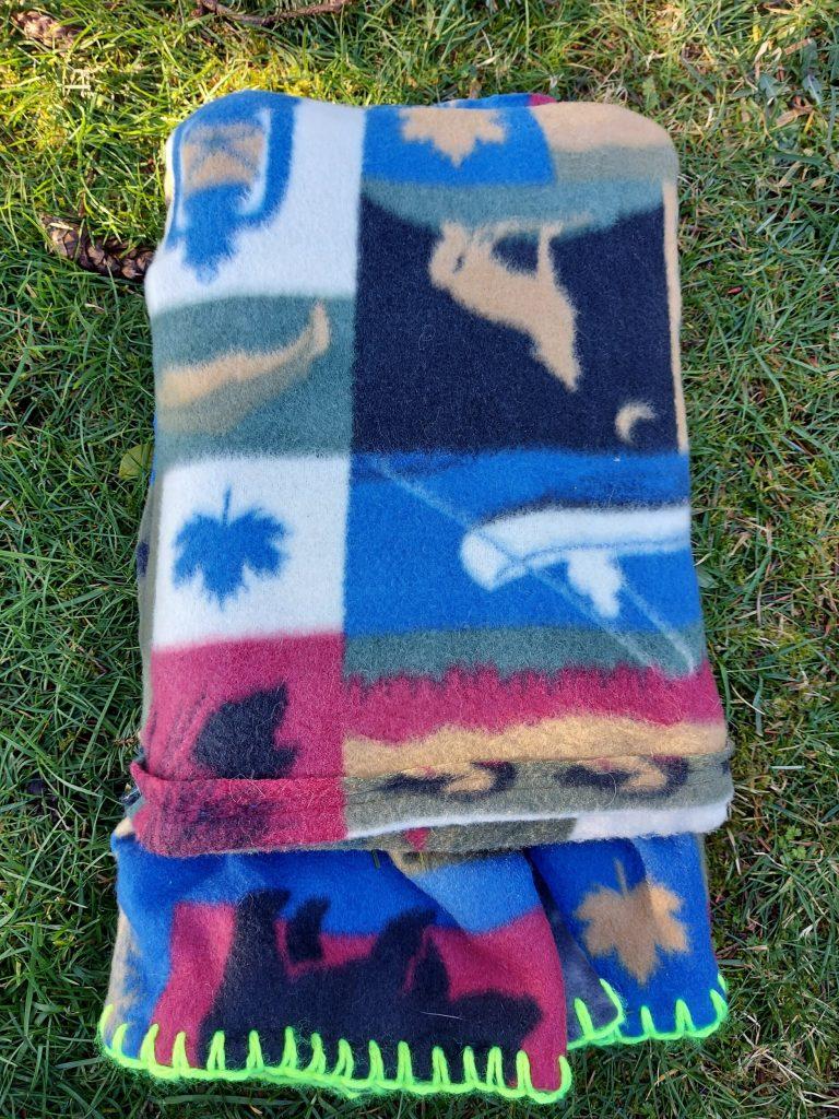 folded blanket inside pocket on the grass