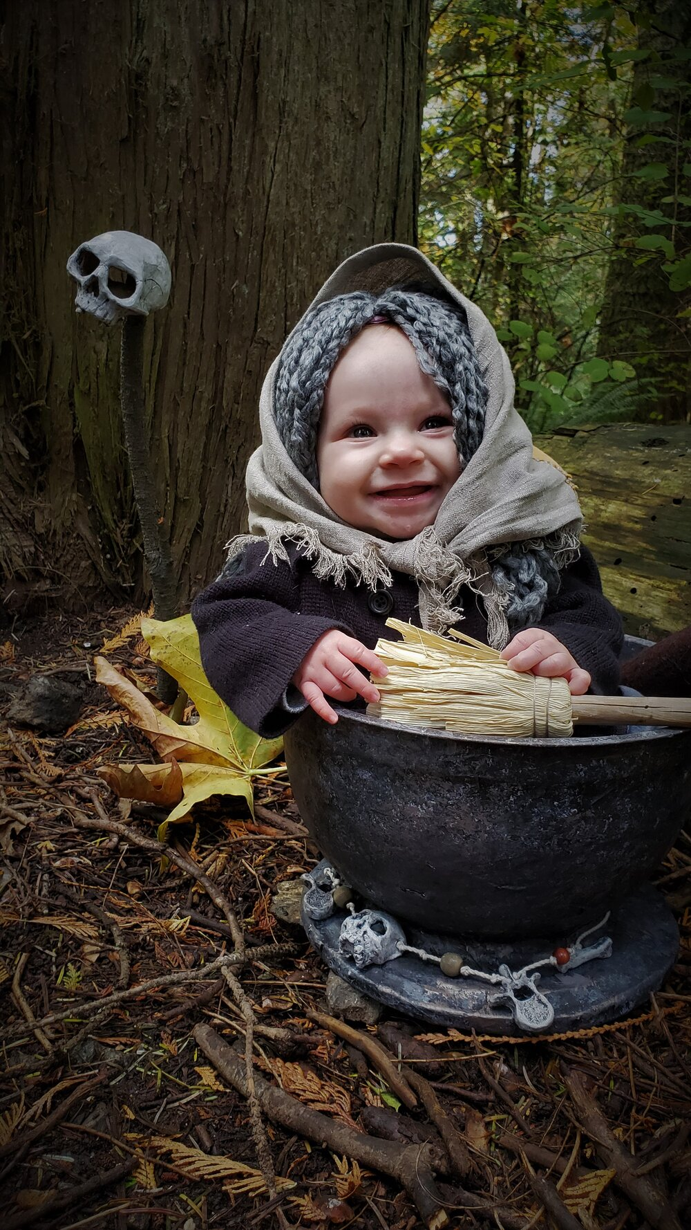 Baby Baba Yaga in mortar happy smiling