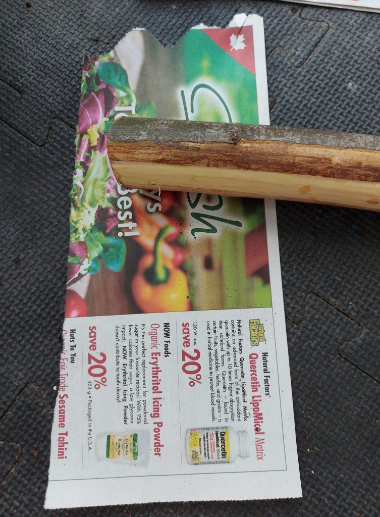 newspaper strip with stick