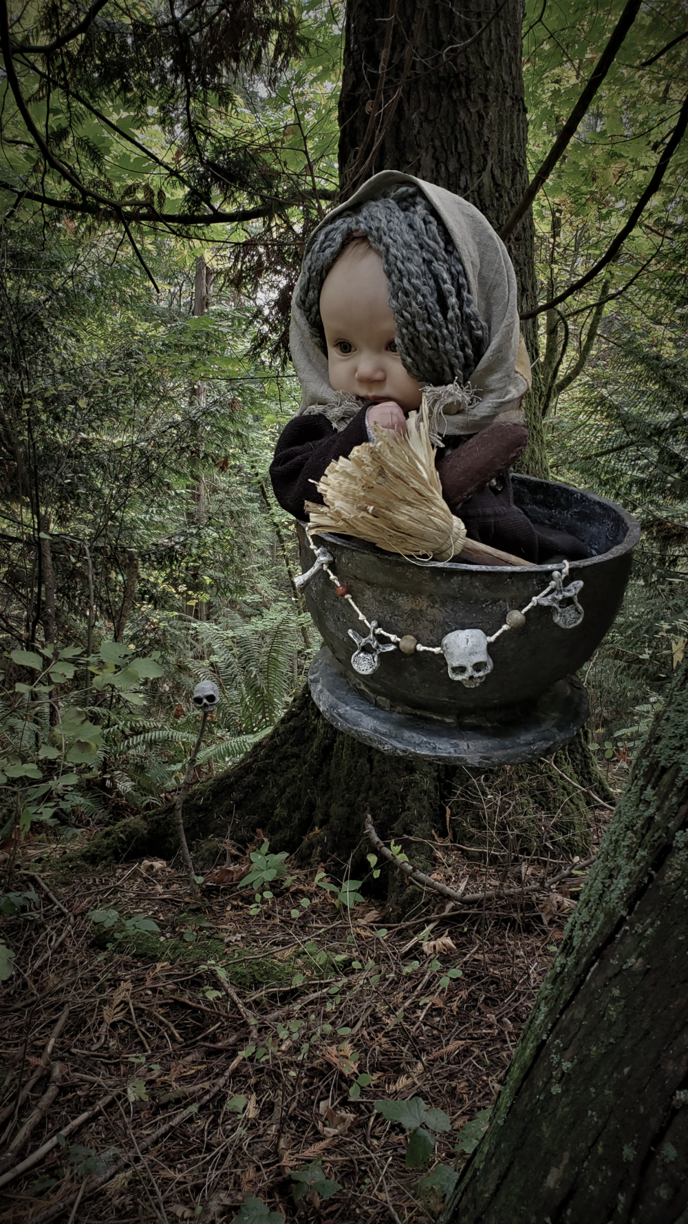 Baby baba yaga flying through the woods in her mortar holding a broom
