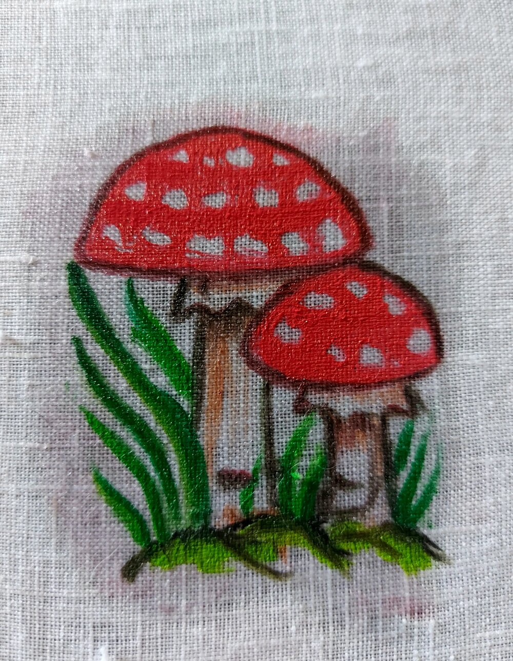 mushrooms and grass painted on white linen