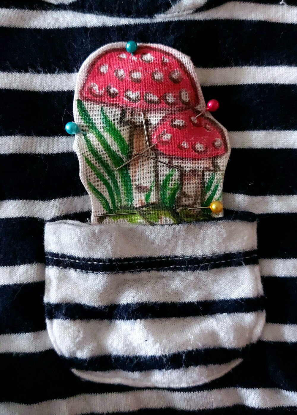 mushroom applique patch pinned onto black and white shirt