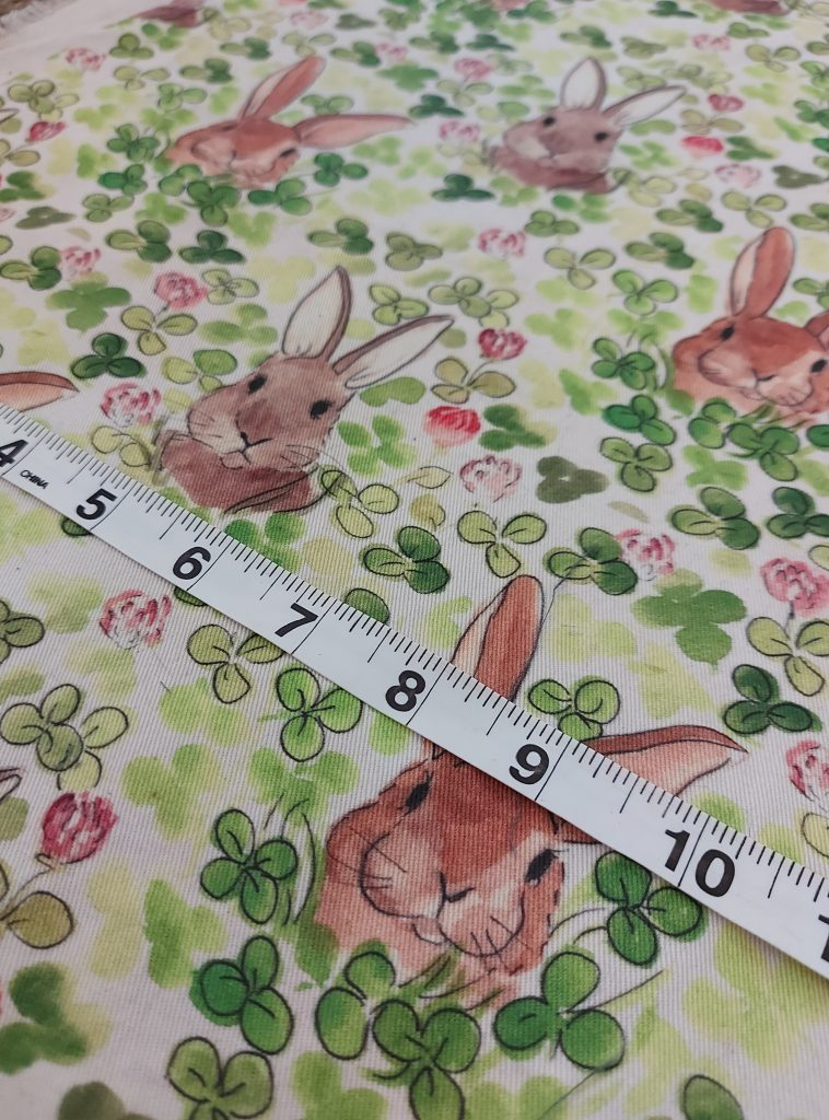 rabbits in clover watercolour fabric