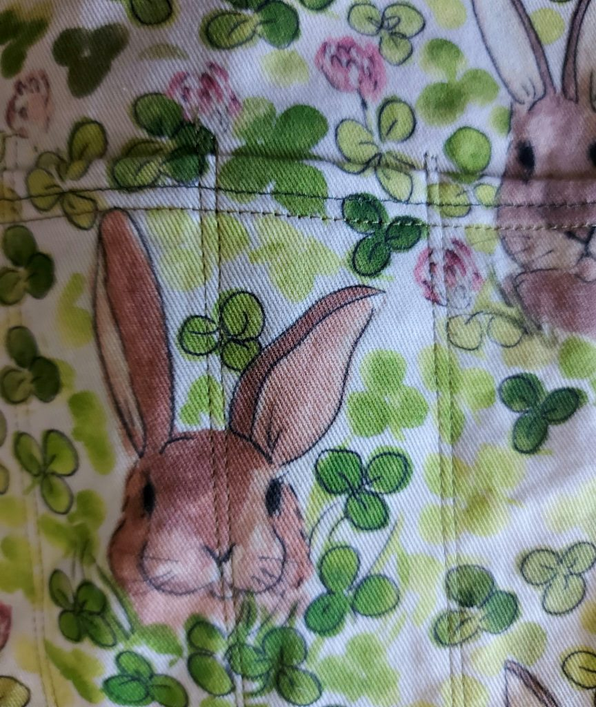 close up pocket stitching on bunny and clover fabric