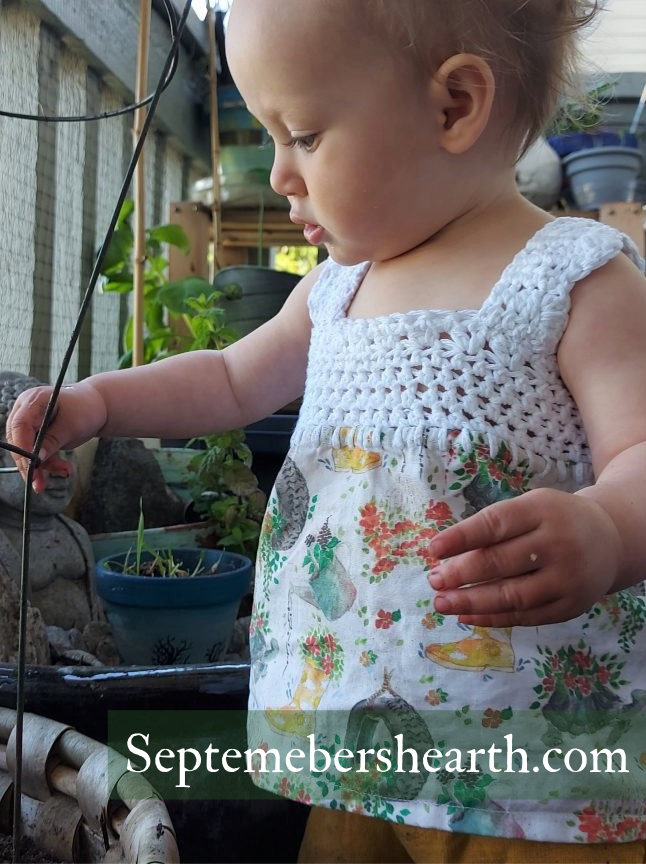 baby girl in crochet and fabric tank top