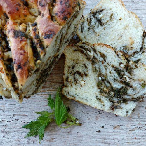 stinging nettle and feta bread slice on board