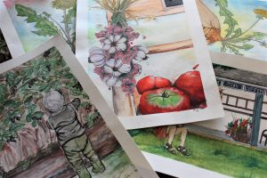 watercolor paintings in a pile