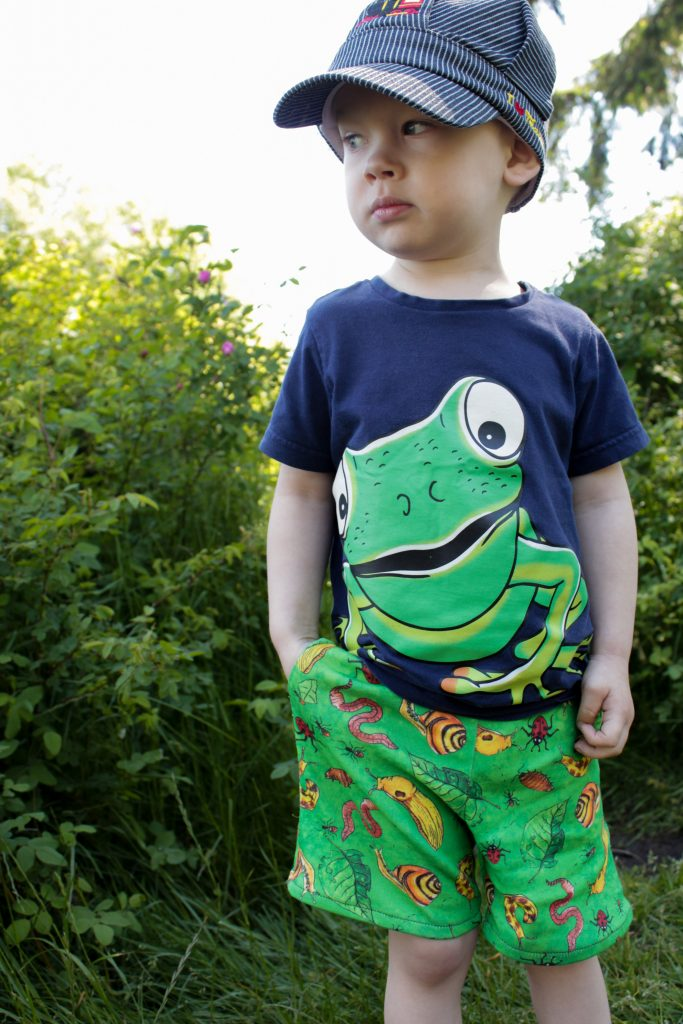 boy in frog shirt and bug shorts
