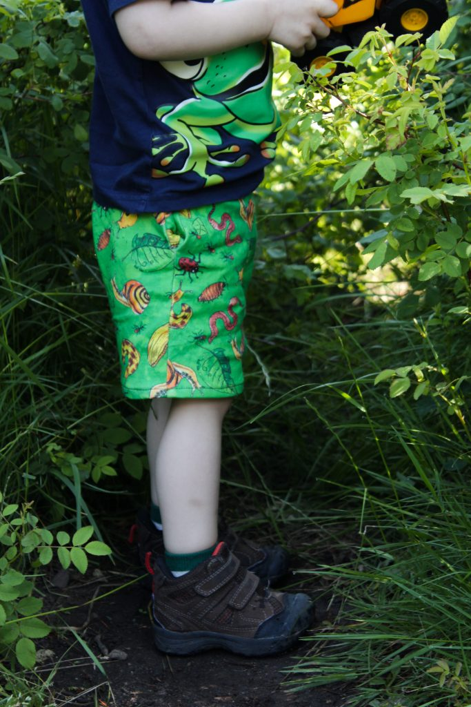 side view boy in bug shorts