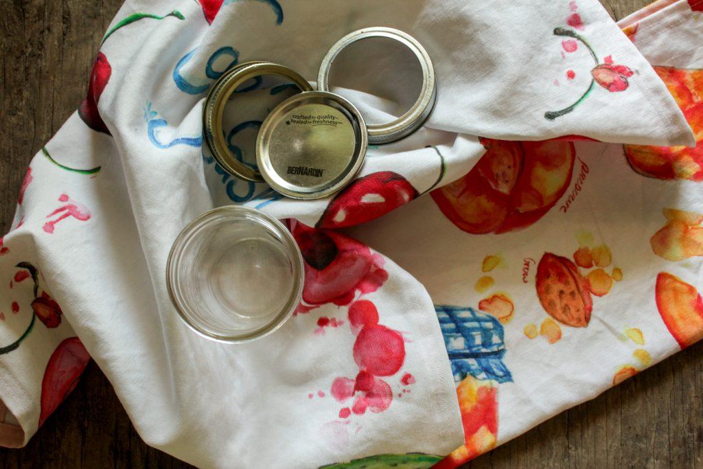 tea towel with canning jar lids and mason jar