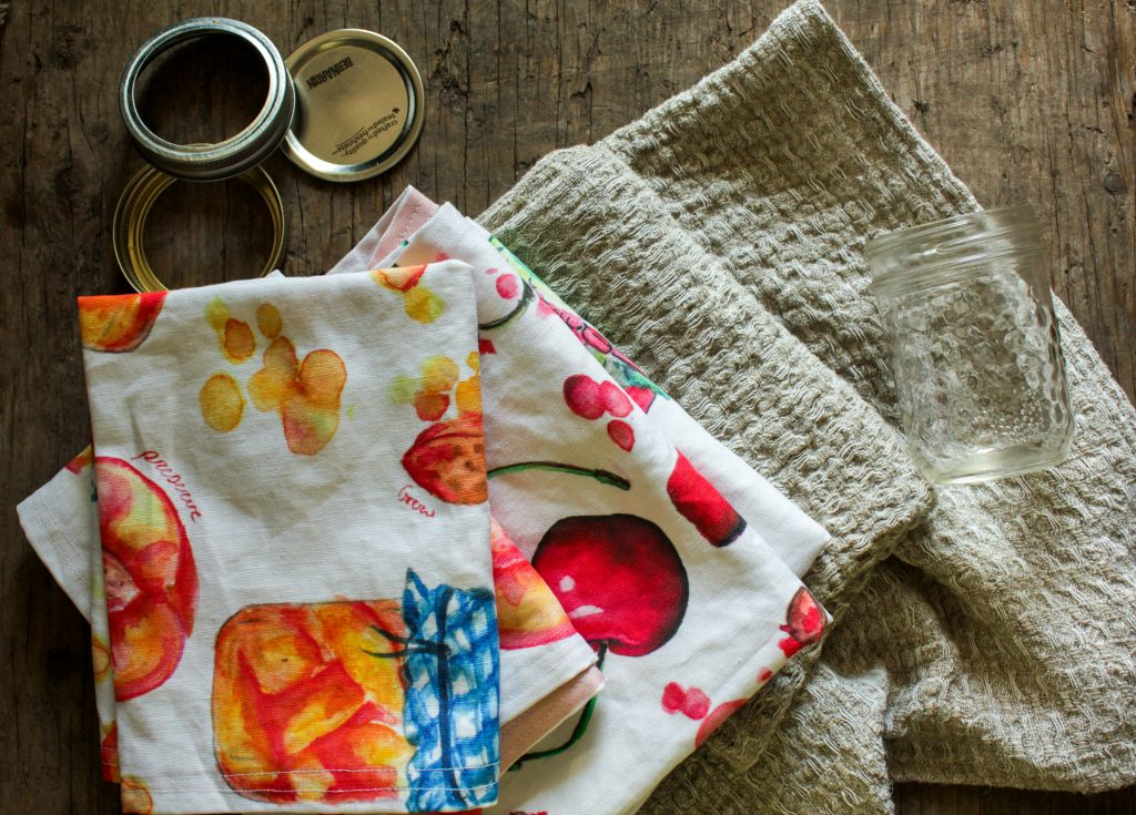 linen tea towels in a stack with canning rings