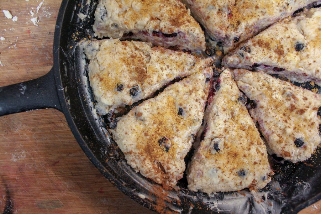 huckleberry scones backed in cast iron pan