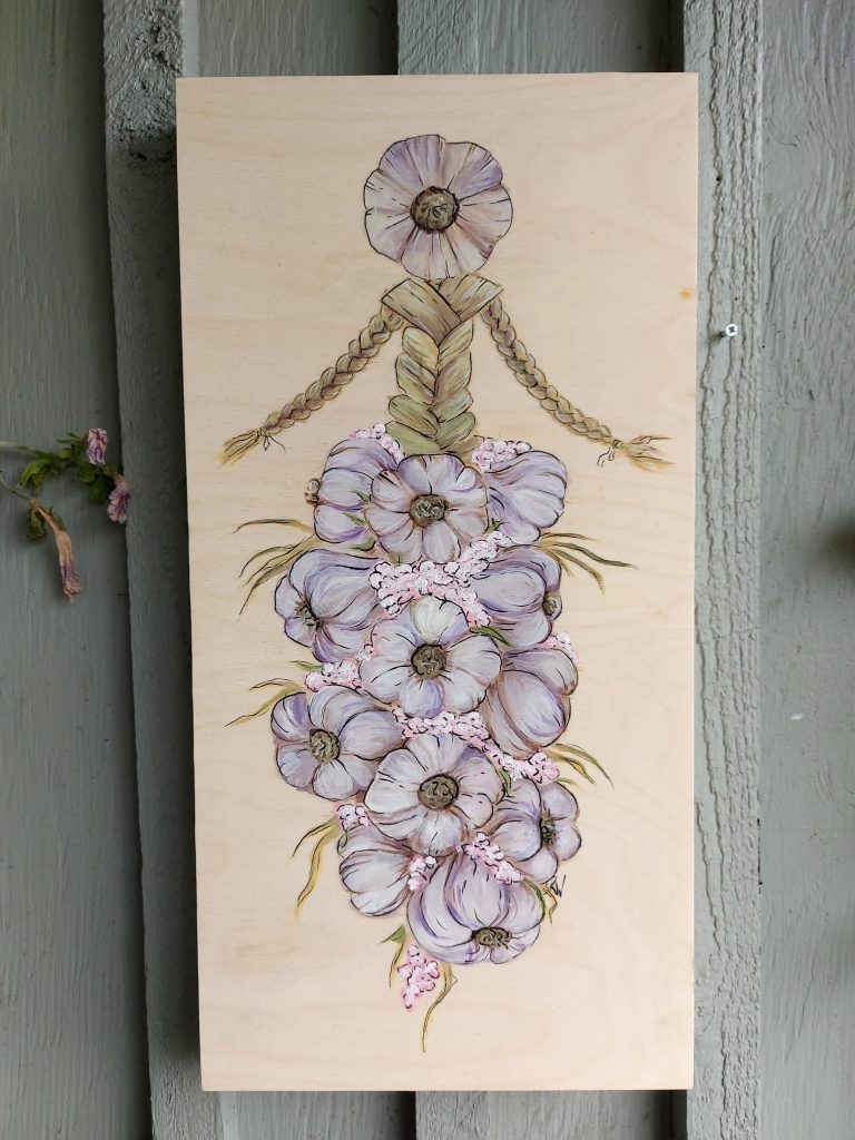 acrylic painting on wood of cornhusk doll with garlic braid dress