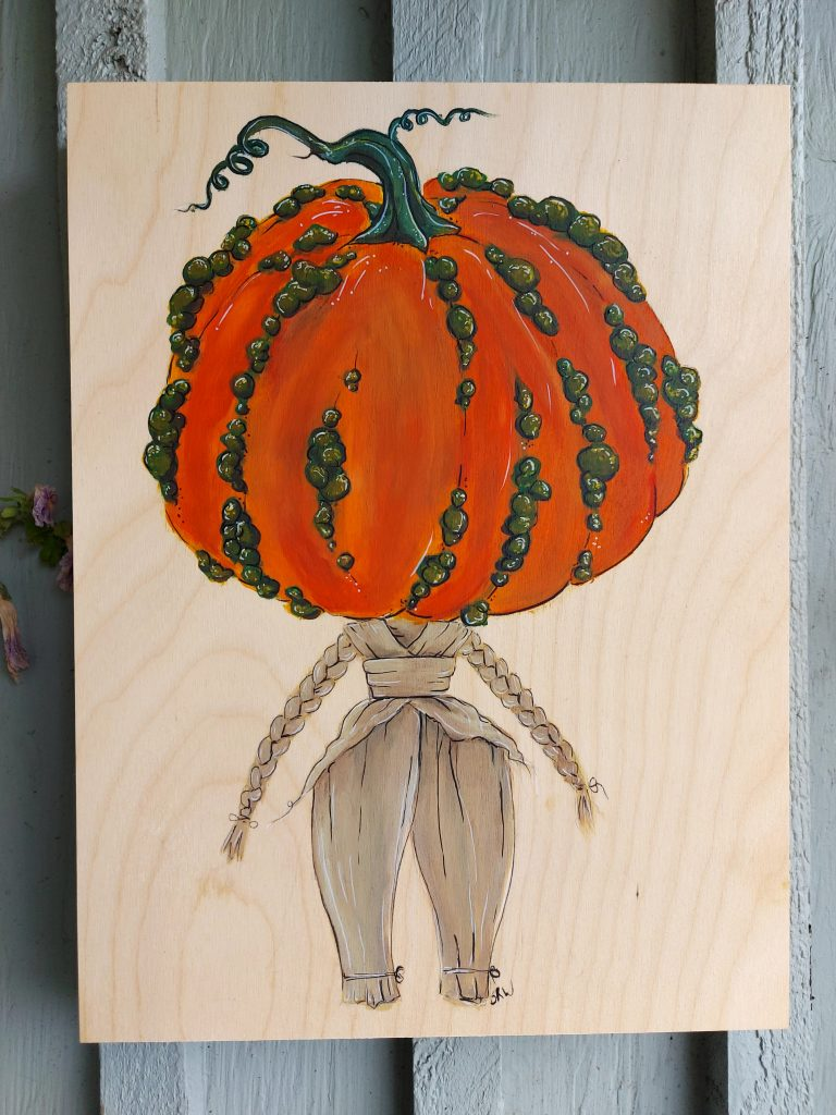 acrylic painting on wood of cornhusk doll with pumpkin head