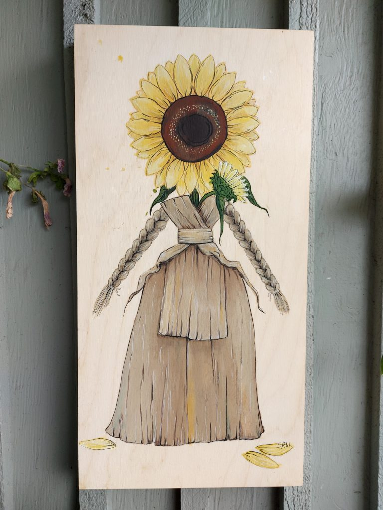 acrylic painting on wood of cornhusk doll with sunflower head